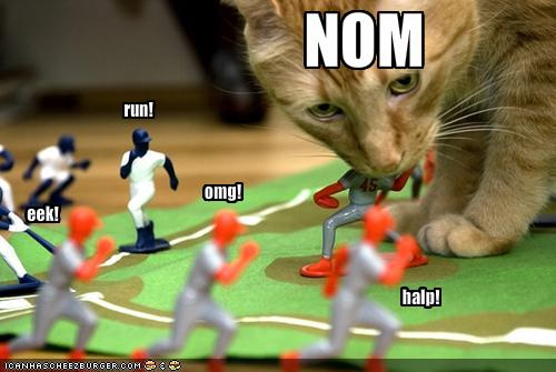 Cat Eats Toy Baseball Players