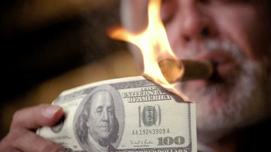 Lighting a Cigar with a 100 Dollar Bill